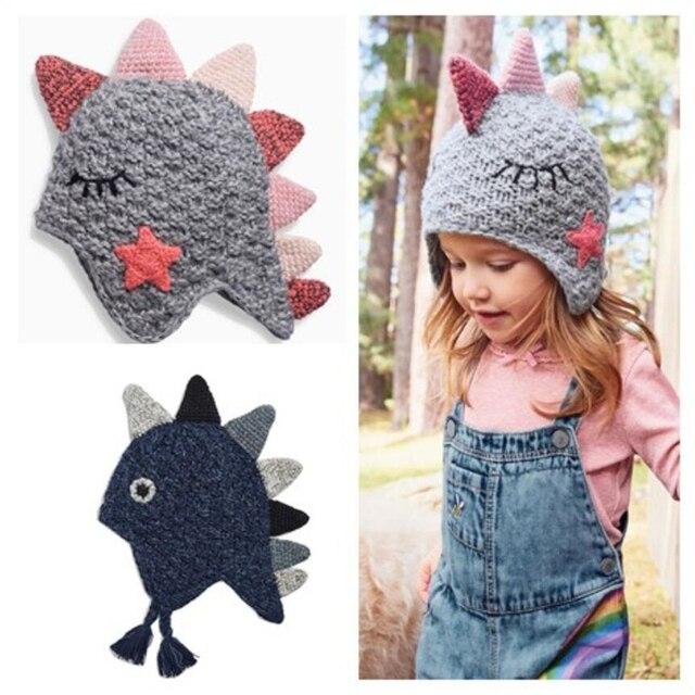 4c767ab342708 STVY Cute Dinosaur Design Baby Boy Girl Knitted Hat Kids Children Animal Beanie  Cap Winter Warm Earflaps Beanies Gift 2 Colors