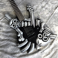 Free delivery, new electric guitar, hand carved skull guitar, black hardware, vibrato system, customizable.
