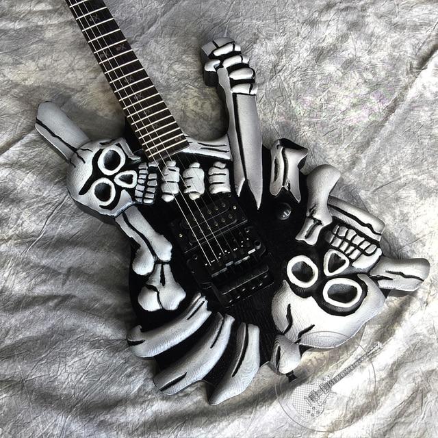 Hand-carved skull guitar, black hardware, vibrato system