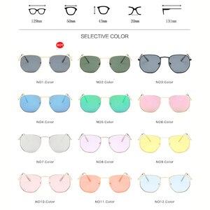 Очки солнцезащитные в круглой металлической оправе
