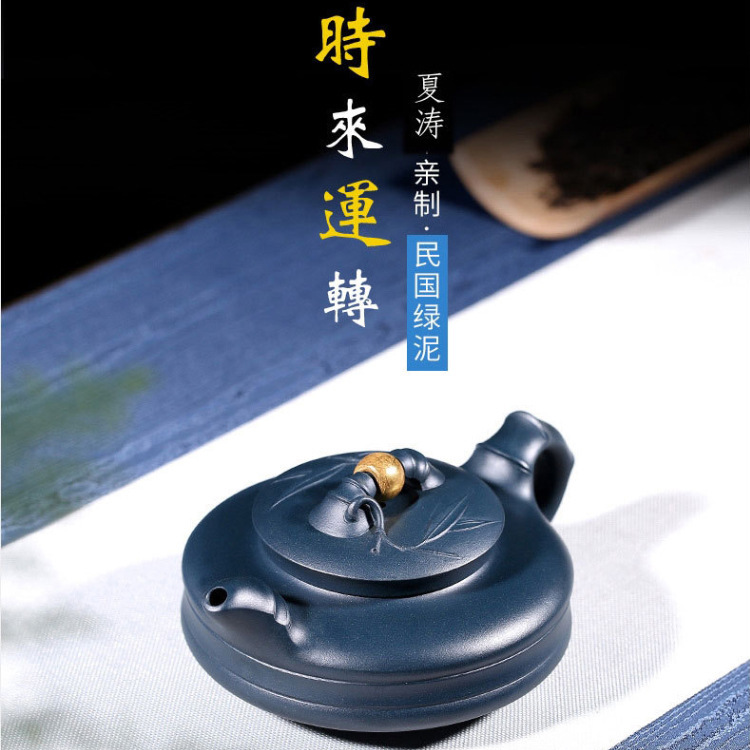 Xia Taoquan, a famous purple clay pot artist in Yixing, runs purple clay teapot traveling tea sets and giftsXia Taoquan, a famous purple clay pot artist in Yixing, runs purple clay teapot traveling tea sets and gifts