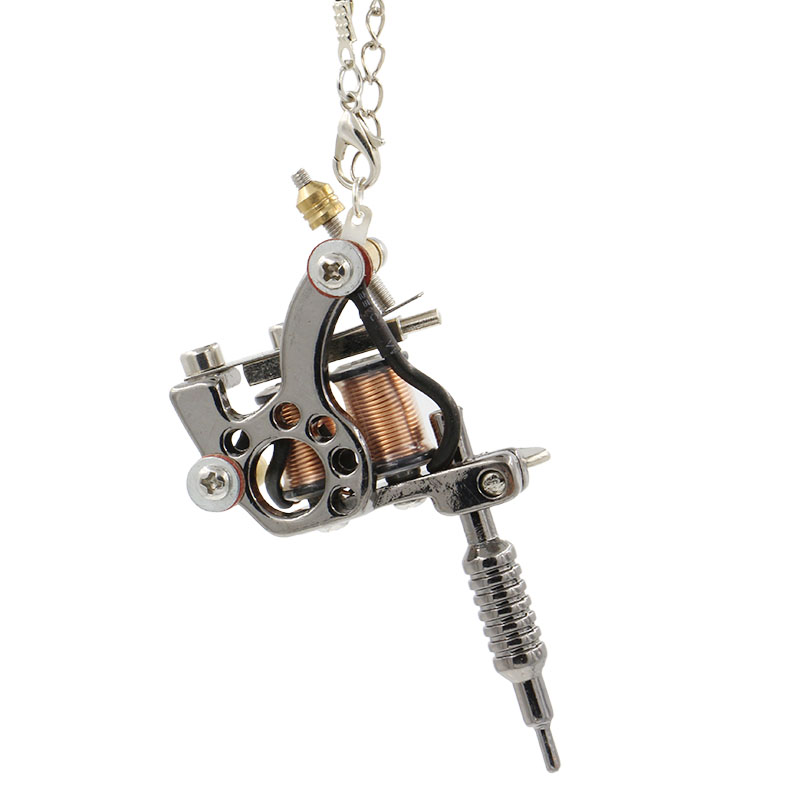 New arrival tattoo rotary machine 1pc mini tattoo machine pendant new arrival tattoo rotary machine 1pc mini tattoo machine pendant with chain lucky seven necklace 45cm free shipping 917 c in tattoo guns from beauty aloadofball Gallery