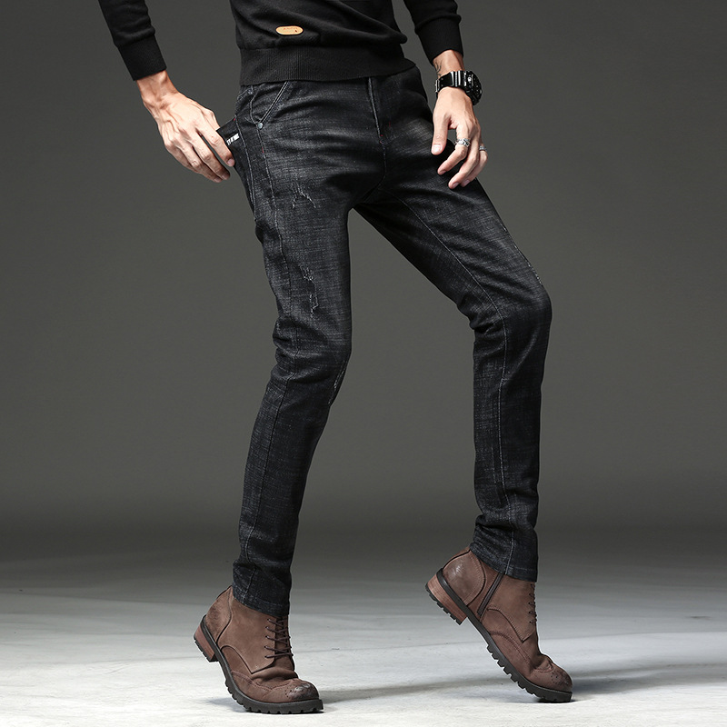 Manufacturers wholesale autumn new cotton mens lap, elastic feet, jeans, long trousers, youth brand 713