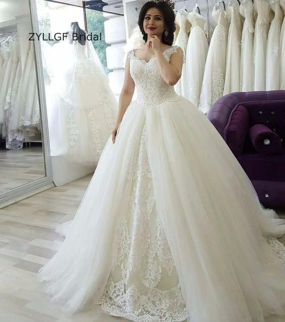 ZYLLGF Da Sposa Medio Oriente Puffy Scollo A V Spazzola Treno Dubai Abito Da  Sposa Matrimoni Dress b9dfe8a20ad