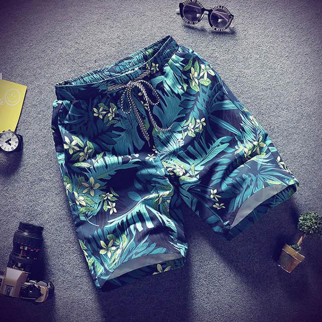 Pantalones cortos informales de verano 2019 para hombre, pantalones cortos de moda de camuflaje para hombre con estampado de flores, pantalones cortos de playa para hombre, envío gratis