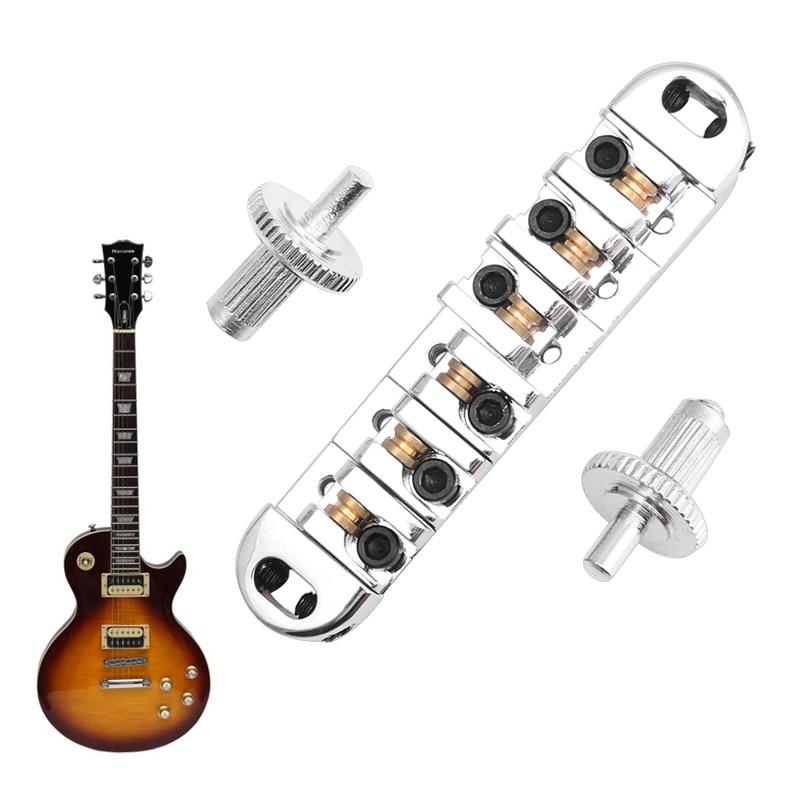 цена 1Pc Roller Saddle Locking Tune-O-Matic Bridge Chrome For Les Paul Guitar New в интернет-магазинах