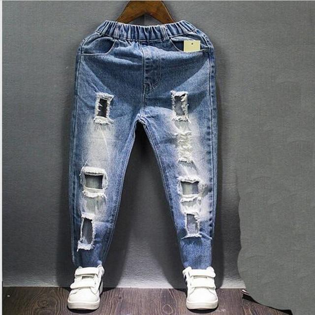 Мальчик дизайнер джинсы брюки новый осень подросток джинсы отверстие, чтобы их ребенок упругие талии длинные брюки джинсовые