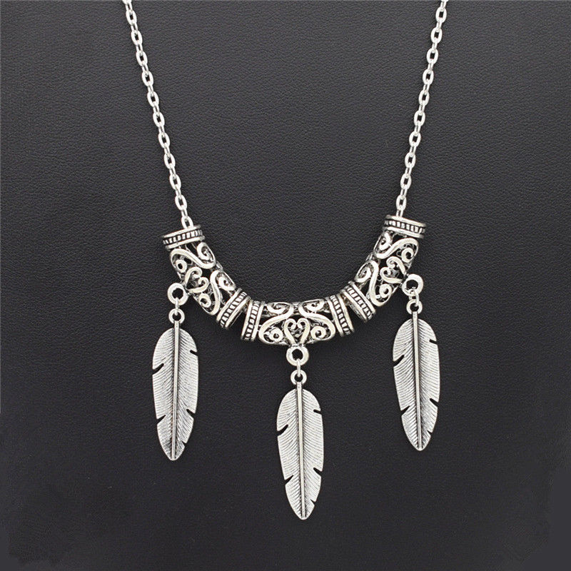 Antique Silver Feather...