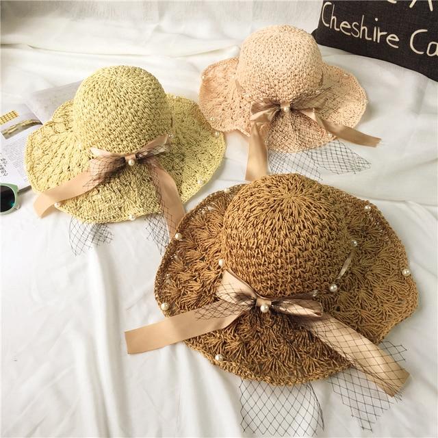 Verano perla neta del hilado del arco hecho a mano grandes aleros sombrero  de Las Mujeres 9e347f351e8