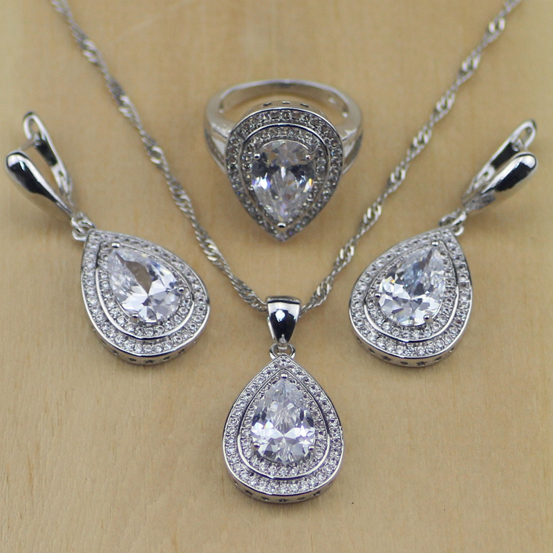 439cf585d19a Moda ovalada cristal blanco ZIRCON 925 plata esterlina Juegos de joyería  para las mujeres Pendientes colgante Collar Anillos t063