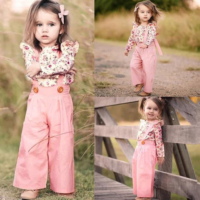 5b557de35 MUQGEW moda bebé Niñas Ropa 2 piezas de manga larga Floral Tops + sólido  pantalones ropa