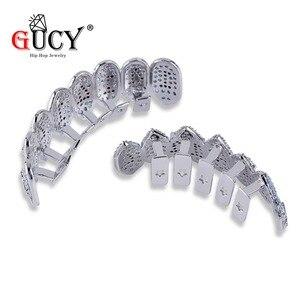 Image 5 - GUCY ледяной хип хоп 1414 зубы Grillz Bling AAA кубический циркон серебряный цвет восемь топ и низ вампир грили набор для подарка