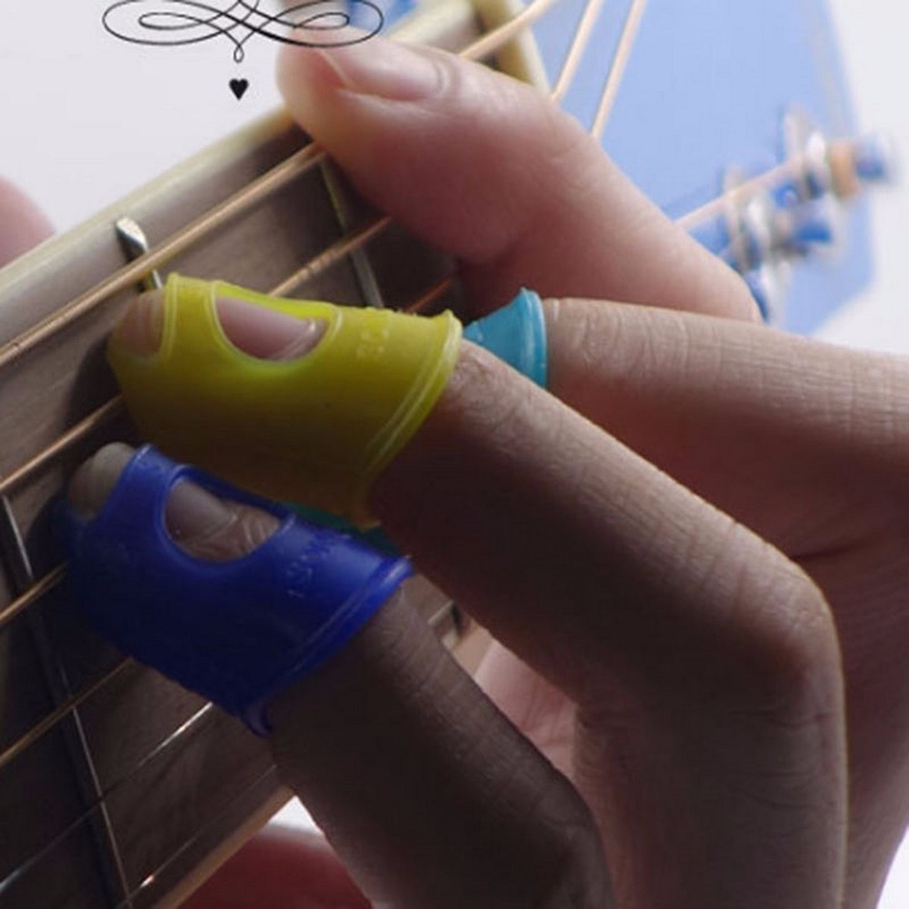 4 pcs/lot Silicone Guitar Fingertip Finger Thumb Picks Plectrums Sheath for Practice for most fingers Random Color