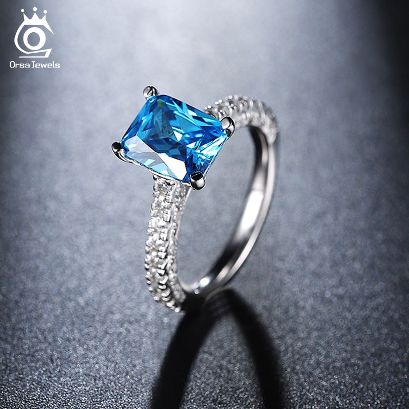 ORSA JEWELS 2019 Fashion 3 Row Crystal Wedding Ring with Big Ocean Blue Zircon Cut Surrounded by AAA Austrian CZ for Women OR139