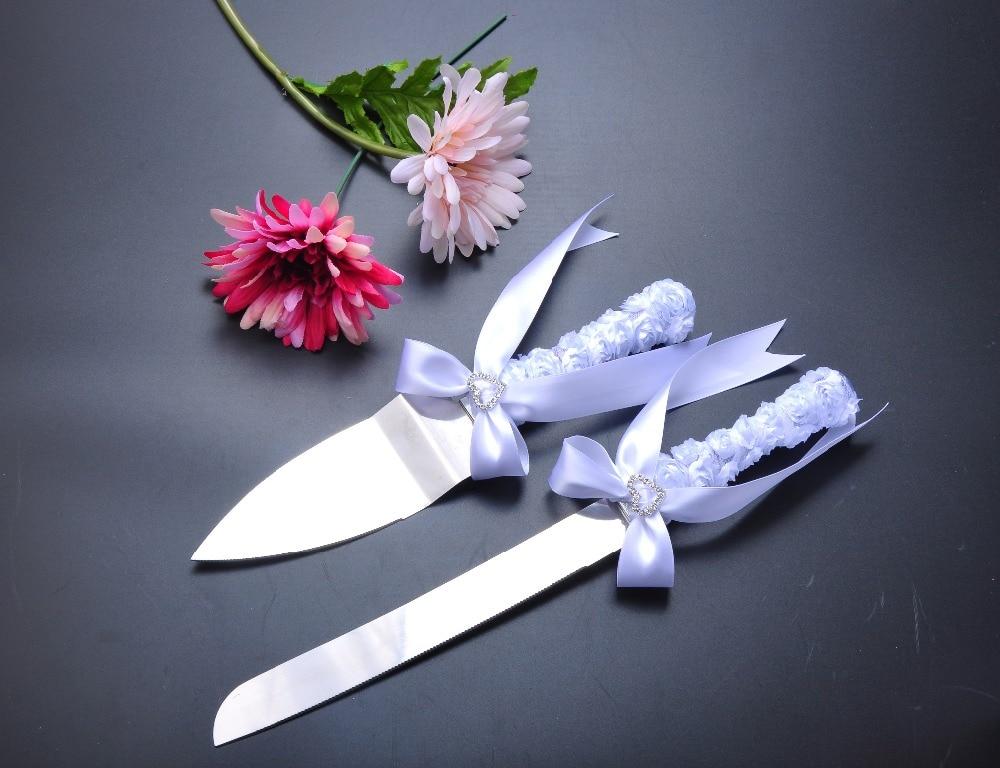 All decorated white ribbon flowers rhinestone wedding cake cutting