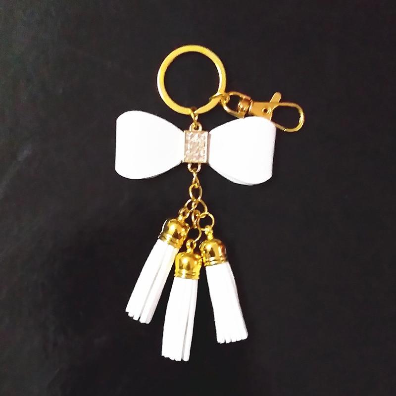 Ny stil Guldkedjor Tassel Nyckelring Läder Tassel Nyckelring Bowknot Tassel Nyckelringar Kvinnor Karabinväska Charmig hänge