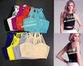 Enchufe de fábrica Al Por Mayor 9 colores de Moda con Sexy Stretch Vendaje Camisa corta (H0468)