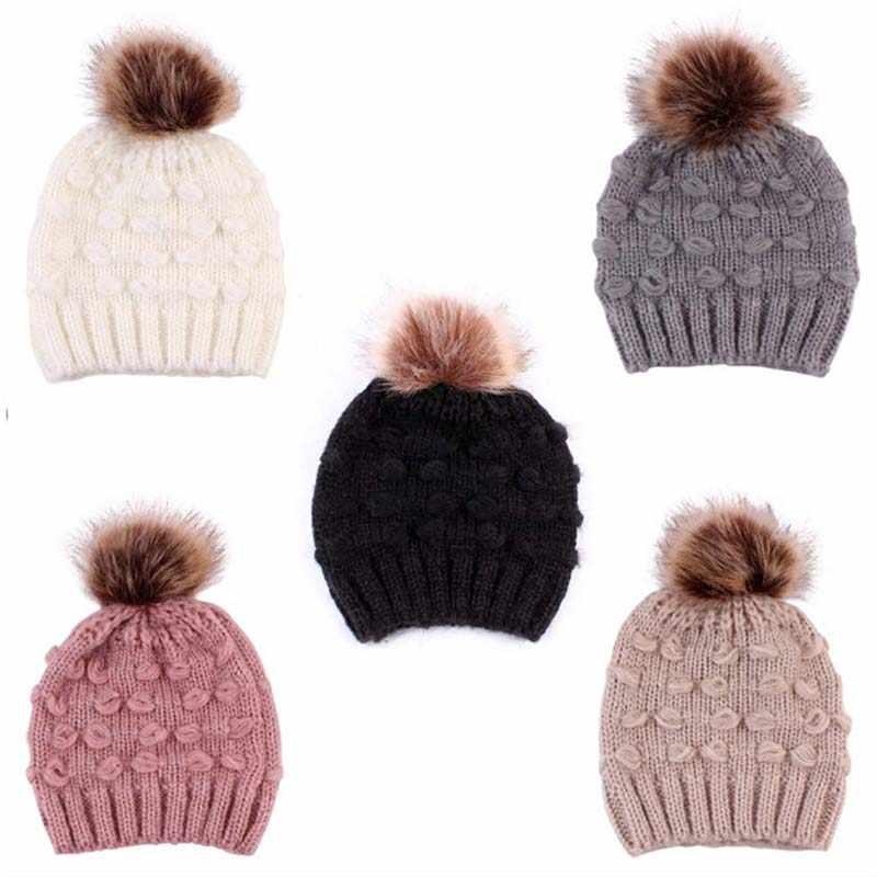 ฤดูหนาวเด็กผู้หญิงเด็กน่ารักถักหมวกเด็กอบอุ่นโครเชต์ Beanie Cape กับ Pom Pom เด็กวัยหัดเดินหมวก 5 สี