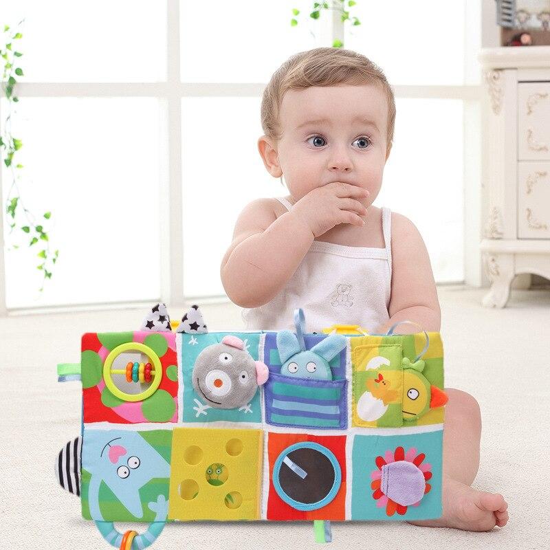 Nouveau bébé jouets Multi-fonctionnelle Mignon de Bande Dessinée Bébé Musique Lit La Paix Livre En Tissu Anneau de Suspension Modèle Kits de Construction TY