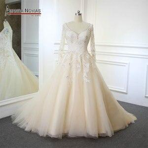 Image 1 - Vestidos de noiva 샴페인 컬러 a 라인 웨딩 드레스 백 홀 2019