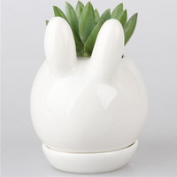 Sáng tạo mới chậu hoa dễ thương rabbit mini gốm ngon ngọt sứ sứ hàng tạp hóa màu xanh lá cây trồng cây mục vụ trang trí