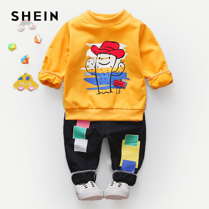 SHEIN Kiddie Cartoon Print Sweatshirt With Pants Boys Two Piece Outfits 2019 Spring Long Sleeve Letter Casual Children Suit Sets men s fashion american flag print usa letter design casual pants