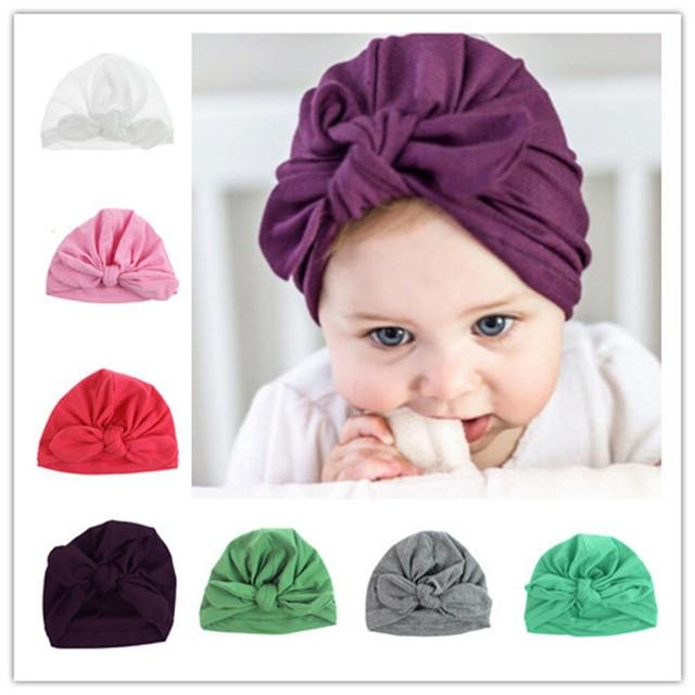 756fa0fd2 Solid Newborn Baby Girl Hat Cotton Infant Caps Elastic Rabbit Ear Headwear  Hot Knot Toddler Hat