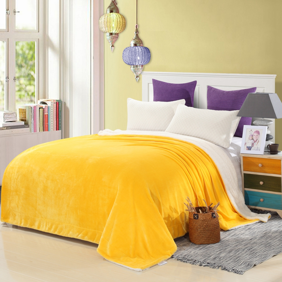 yellow solid color throw blanket on the bed soft flannel fleece