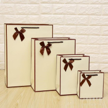 Free Design 100PCS/LOT Cream-coloured Paper Gift Bag Packing Print LOGO Shipping