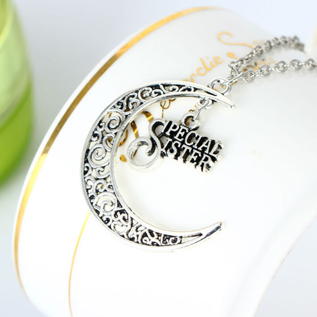 Bespmosp 24pcslot wholesale fashion glow in the dark moon retro bespmosp 24pcslot wholesale fashion glow in the dark moon retro style special sister pendant mozeypictures Image collections