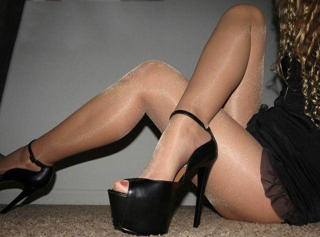 In glossy pantyhose and tight