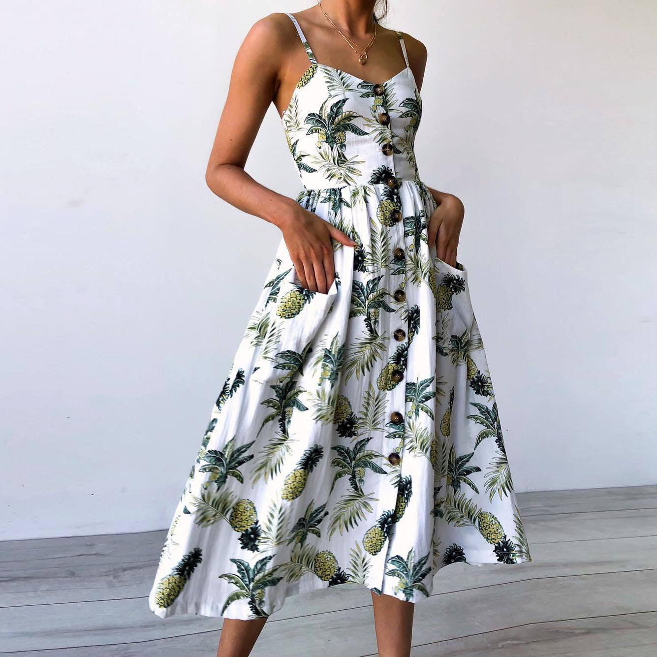 Vestido de verano con estampado Floral bohemio para mujer con cuello en V y bolsillos sin mangas vestidos Midi plisados de girasol para mujer con botones y espalda descubierta