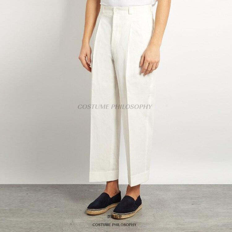 Design Original blanc pantalon décontracté 2018 personnalité ceinture peut desserrer le défilé de mode pantalons pour hommes. 27-44 vêtements sur mesure