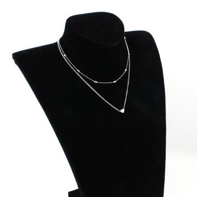 Фото женское двухъярусное ожерелье брендовое с двойным рогатым сердцем цена