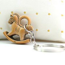 The Current Creative Cartoon Keychain Chain Modeling Small Horse Key Ring Creative Jewelry Wood