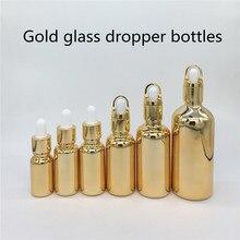 10ml,15ml,20ml,30ML,50ml,100ml botella de vidrio dorado con gotero botella de aceite esencial, botellas de Perfume 100 piezas