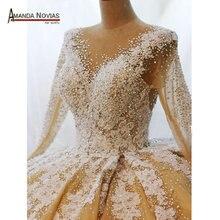 למעלה איכות מלאה ואגלי פניני חתונה שמלה עם שרוולים ארוכים 2020 שמלת כלה