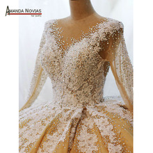 Top quality full beading pearls wedding dress with long sleeves 2020 wedding gown