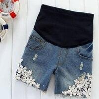 Mùa hè mang thai màu xanh jeans ngắn thai sản Ripped ren chắp vá Denim Shorts mang thai quần cộng với kích thước quần áo thời trang 2015