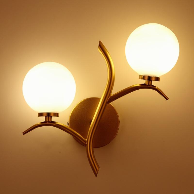 купить Simple American Golden Black Double - headed wall lamp Corridor The study Background wall Balcony Wall lamp по цене 4243.72 рублей