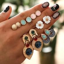 RAVINOUR Tiny Shell Flower Stud Earrings