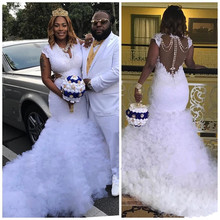 Saudi Arabic Sexy Plus Size Lace Wedding Dresses Waist Cut Pearls V-neck Ruffles Train Tulle Capped 2019 White Boho Bridal gowns