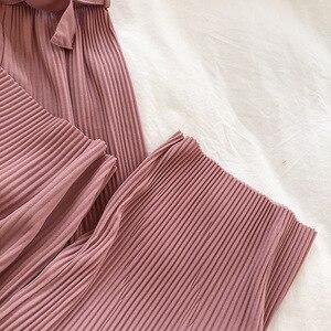 Image 5 - YuooMuoo lato elegancki styl regularne spodnie do kostek szerokie nogawki solidne plisowane spodnie wiosna wysokiej talii paski spodnie ściągane sznurkiem