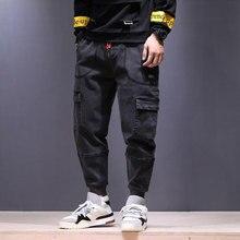 2018 High Street moda hombres pantalones vaqueros estilo japonés Punk Harem  Pantalones negro gris Hip Hop Jogger Jeans hombres B.. 04dee657f46