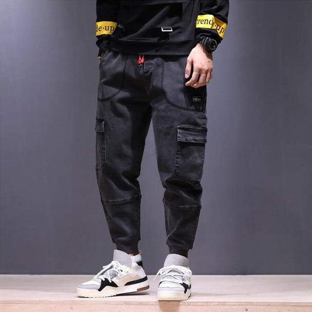 2018 High Street moda hombres Jeans estilo japonés Punk Harem Pantalones  negro gris Hip Hop Jogger 3a28de36f37