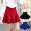 Niñas de punto resorte de la falda de ropa para niños niñas moda casual knit basando la falda perla princess tutu faldas niño salvaje