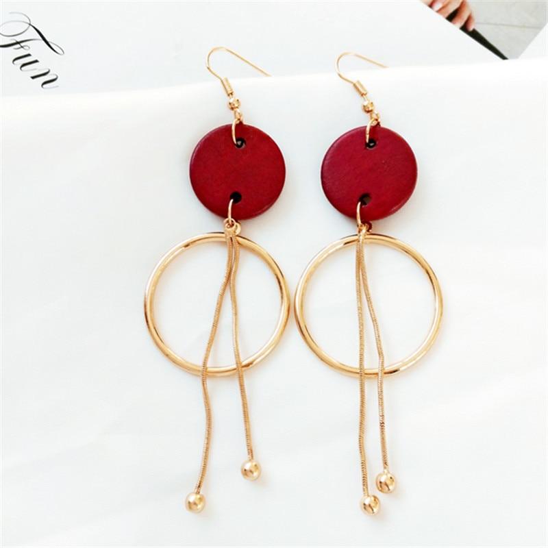 Original design cooling female retro eardrop log long metal tassel earrings round wood earrings in Stud Earrings from Jewelry Accessories