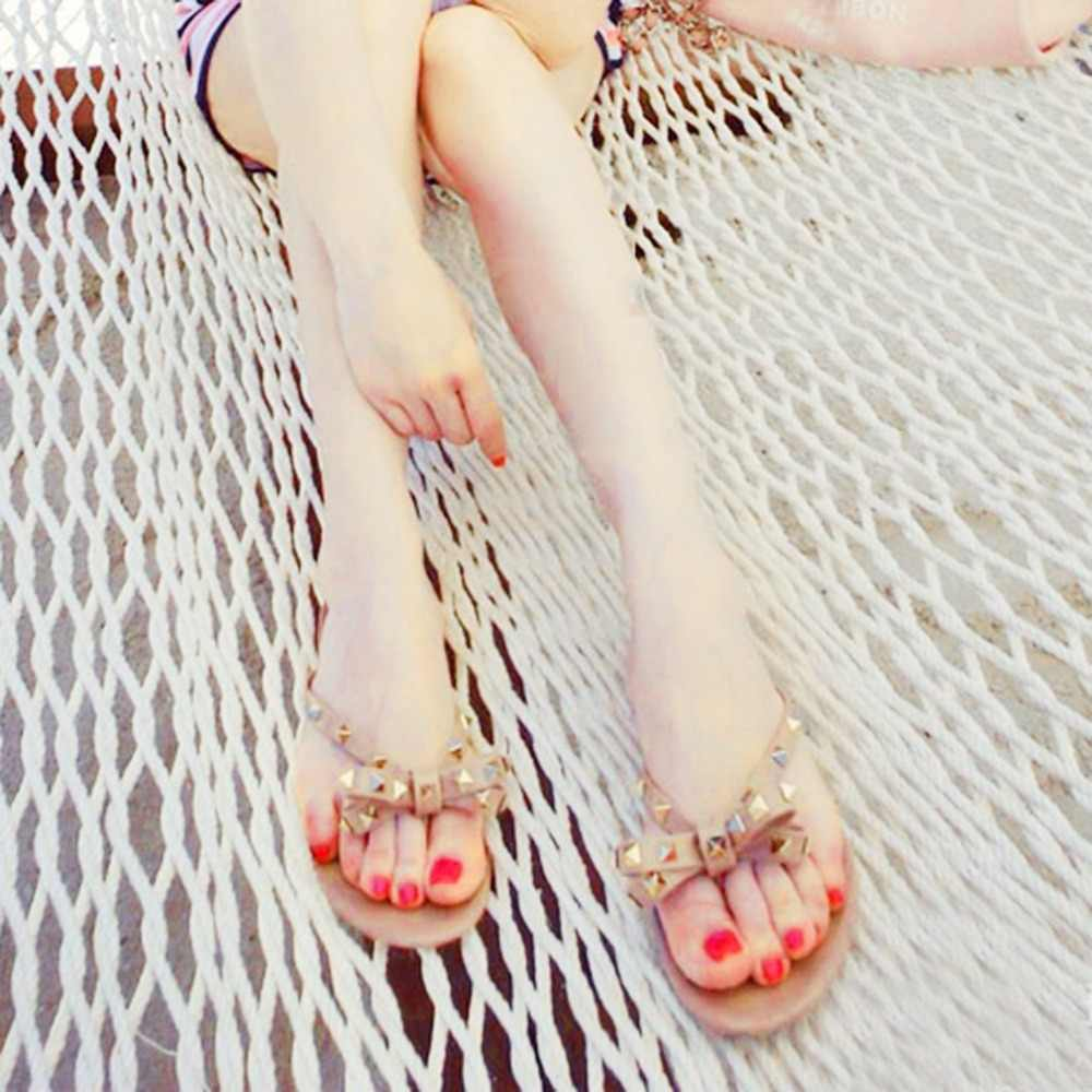 6ee7ef6c5175e ... OUTAD Fashion Woman Flip Flops Summer Beach Rivets Bow flat Plastic  Sandals Jelly Shoes Sandals For ...