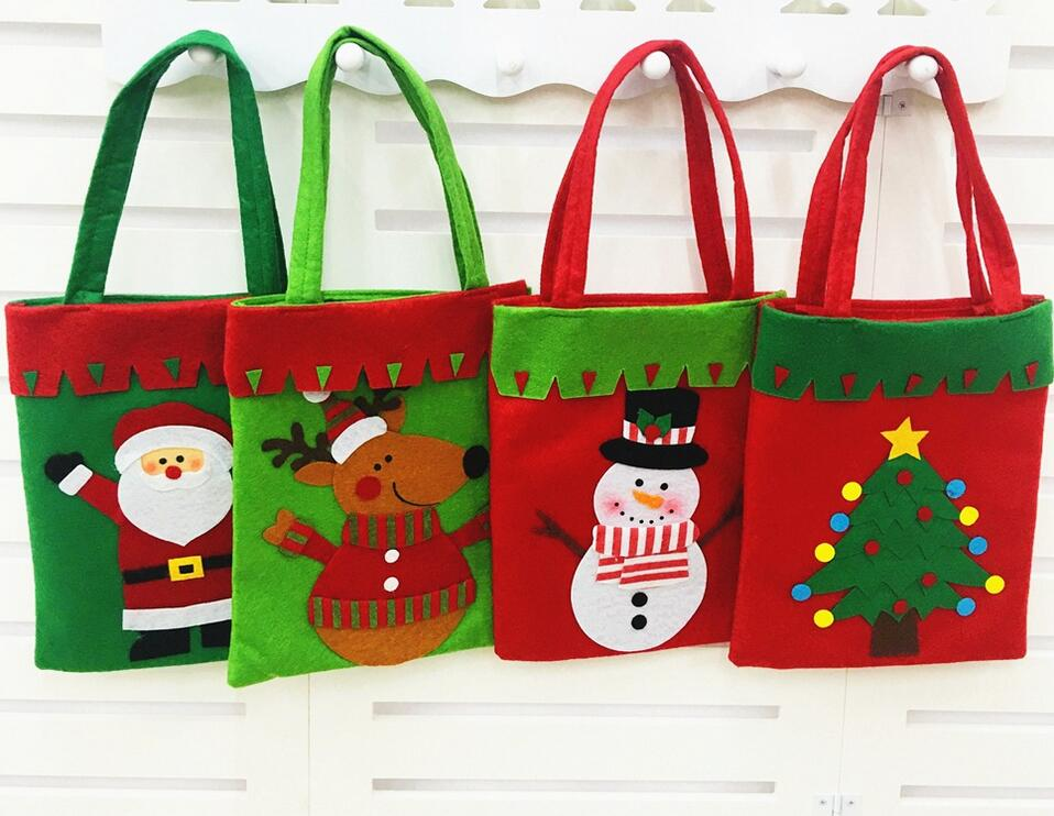 500pcslot new santa claus gift shopping bags merry christmas tree pattern candy bags handle bag xmas carnival by tntfedexdhl - Christmas Tree Bags