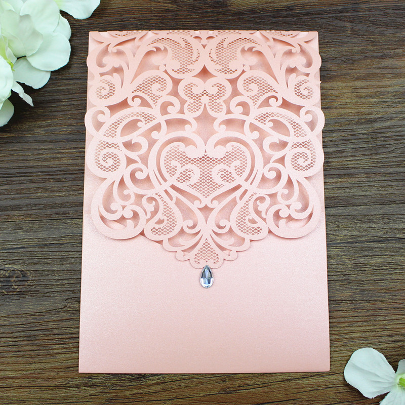 Pink jeweled pocket wedding invitations elegant floral laser cut
